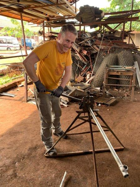 Herman cutting a pipe