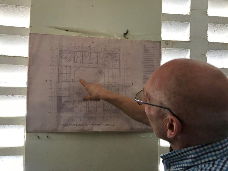 Rob checks the building plans